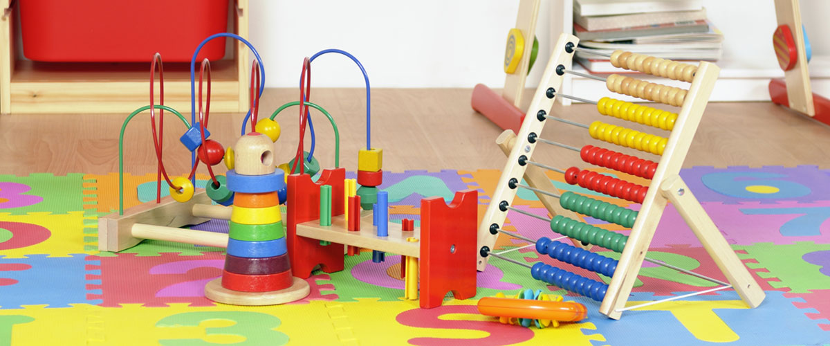 Wooden toys on play mat.